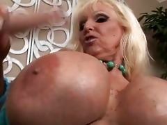 tanned blonde with giant milk shakes engulfing